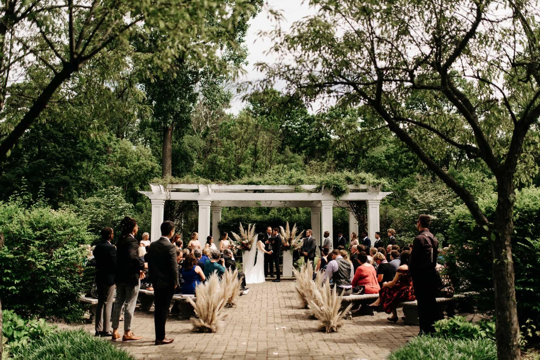 wedding ceremony under the pergola at wellers in saline michigan