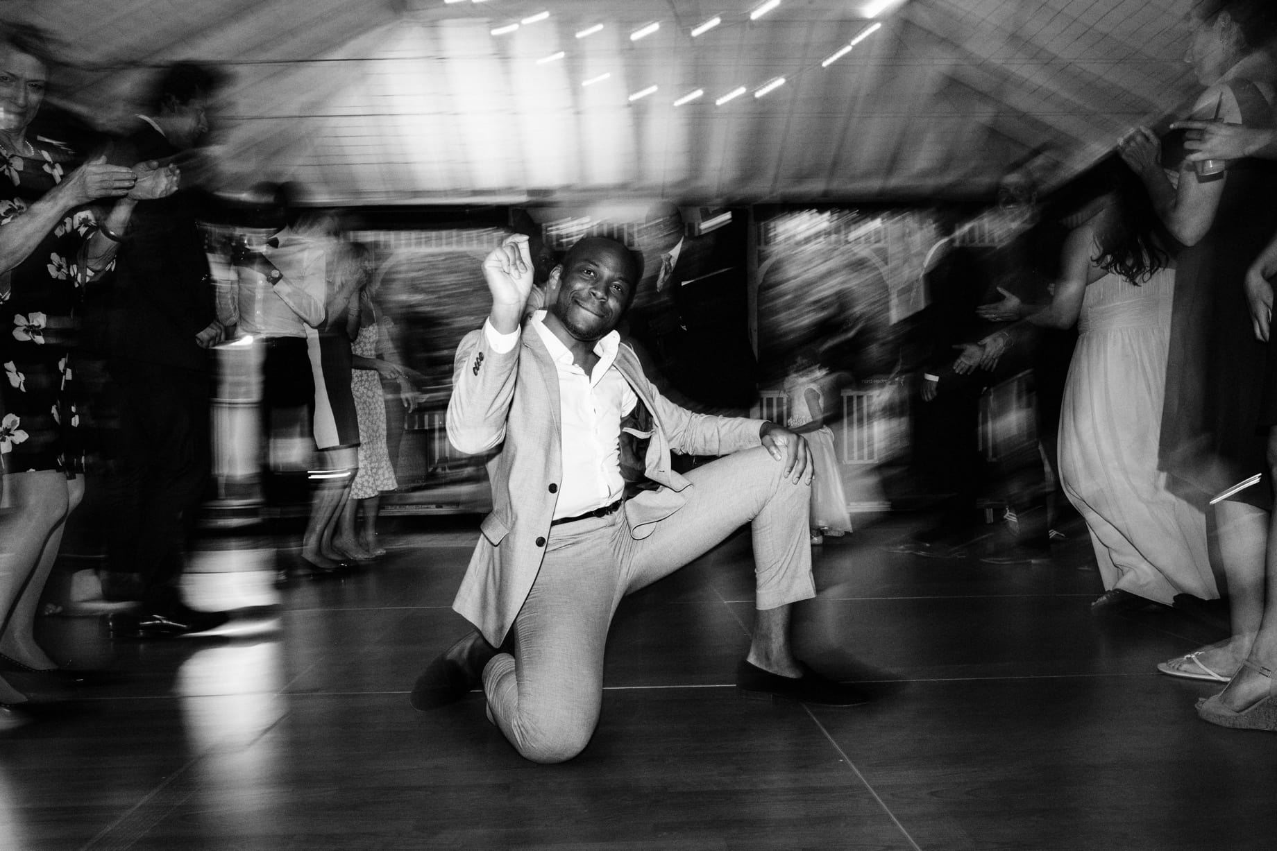 groomsman busting a move at wellers