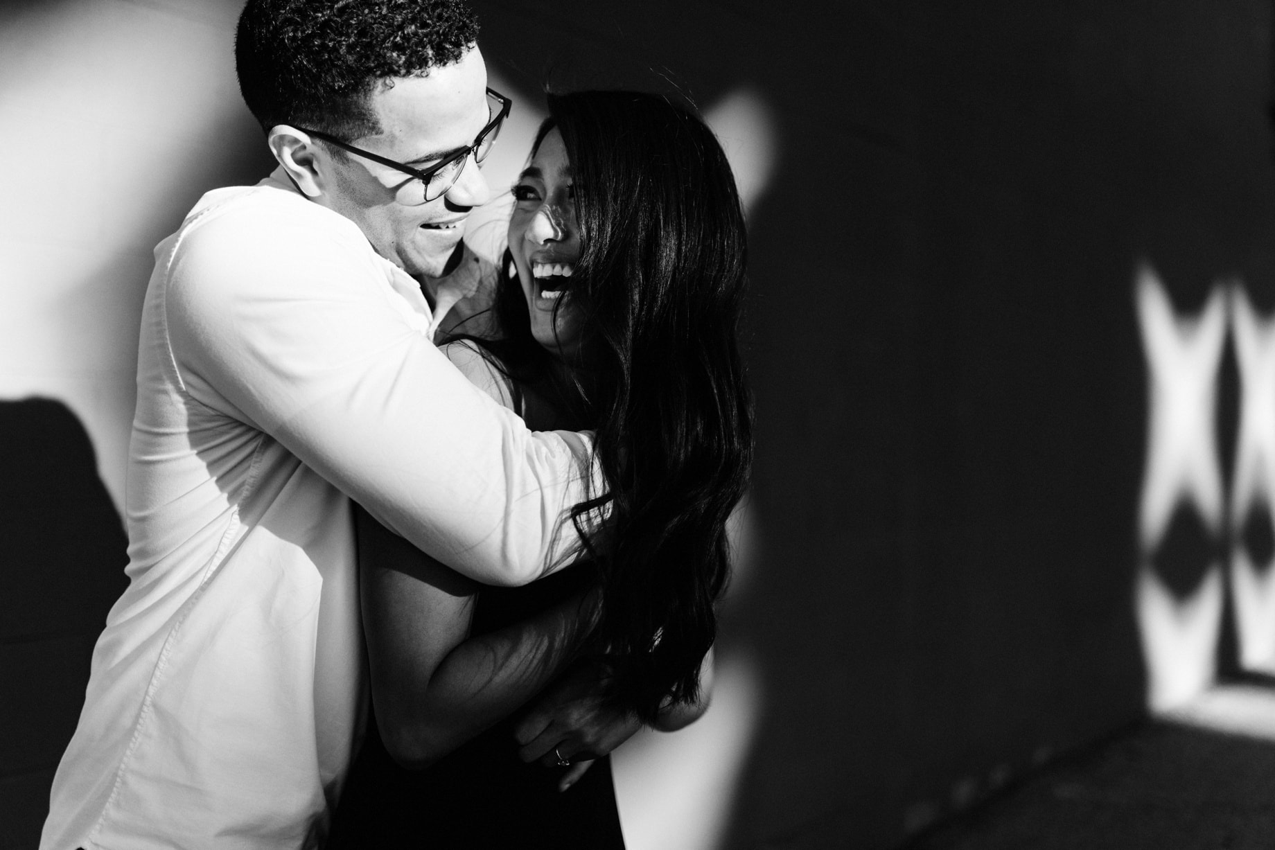 a black and white portrait of a couple during their engagement session in grand rapids