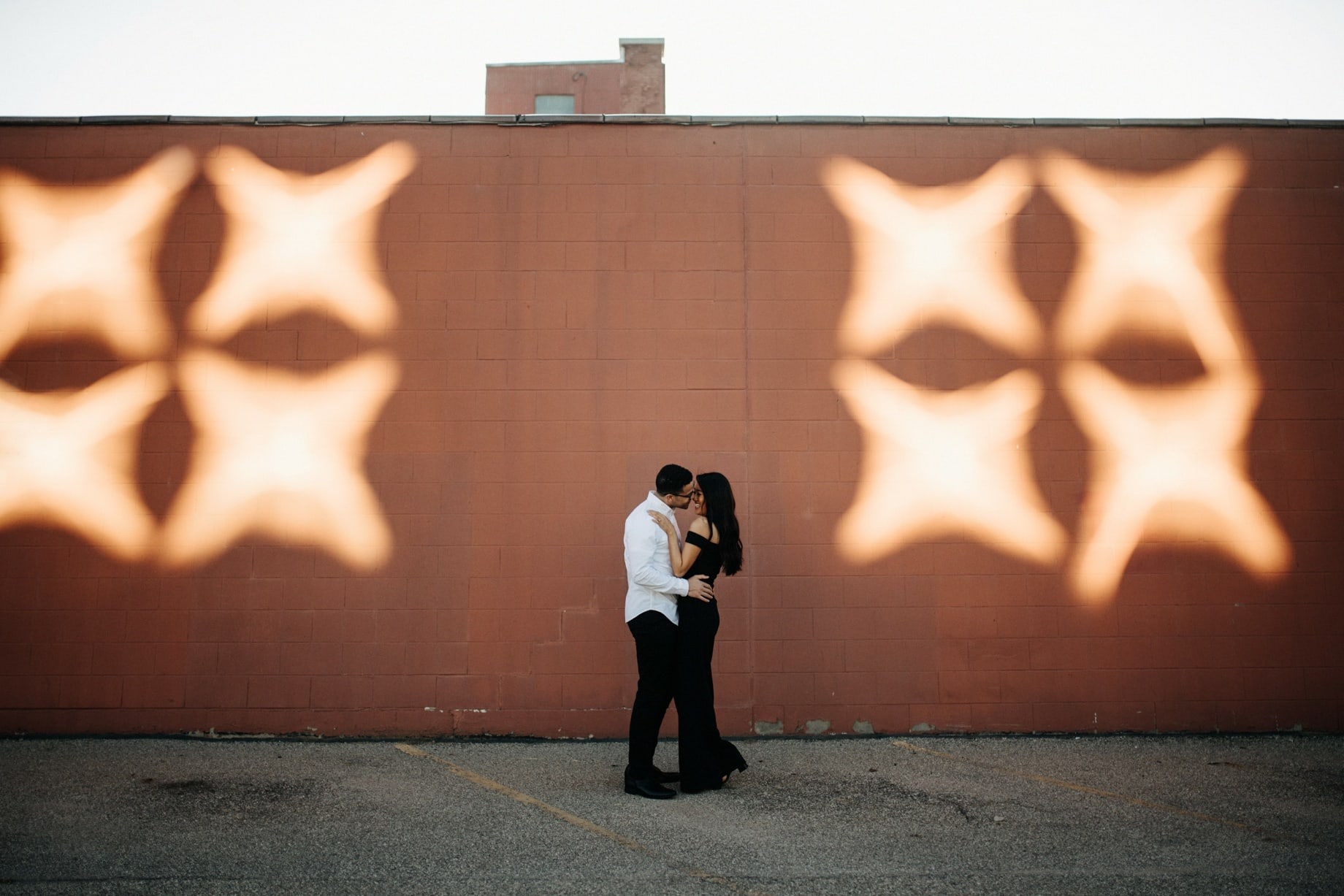 a stylish couple poses for portraits in grand rapids