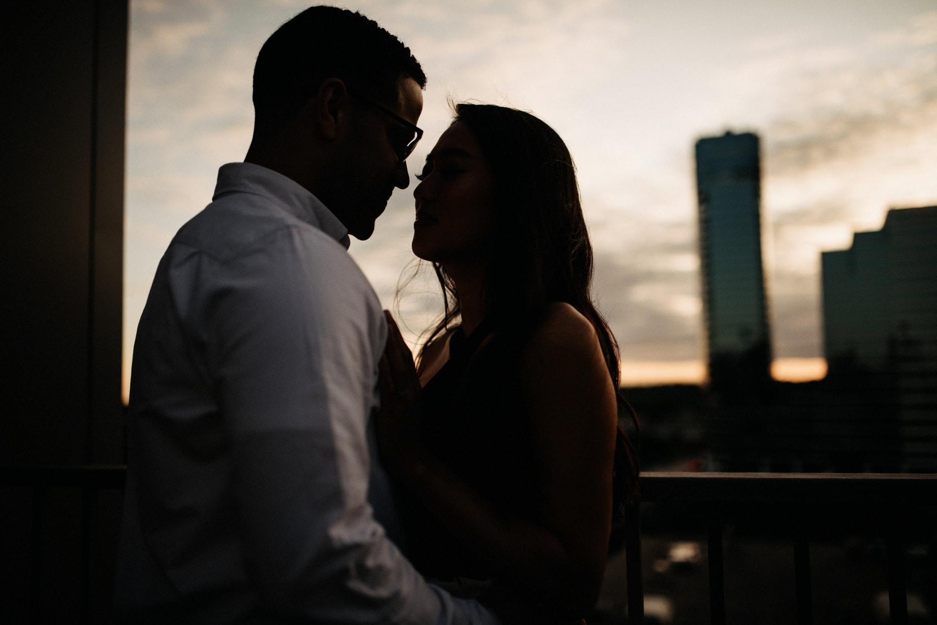 engagement photos on a rooftop in grand rapids at sunset