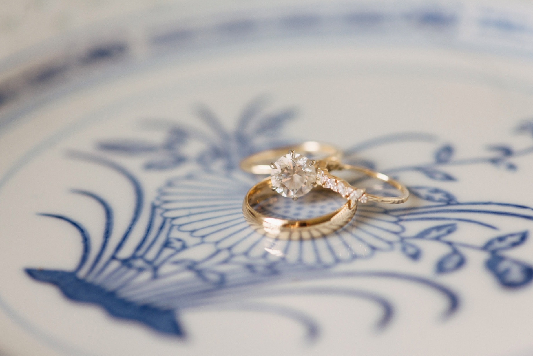 a detail shot of rings on a blue and white plate