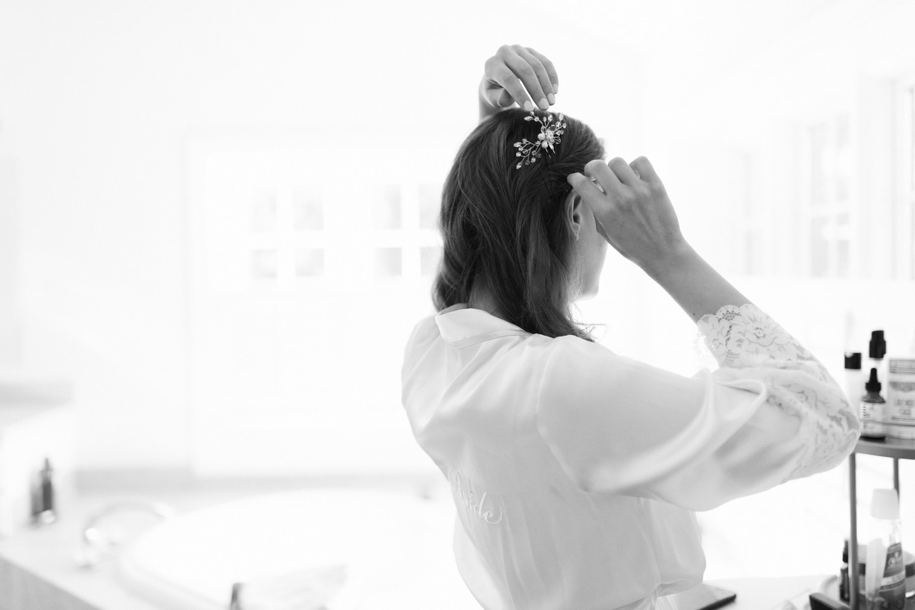 Bride adjusting a hair comb
