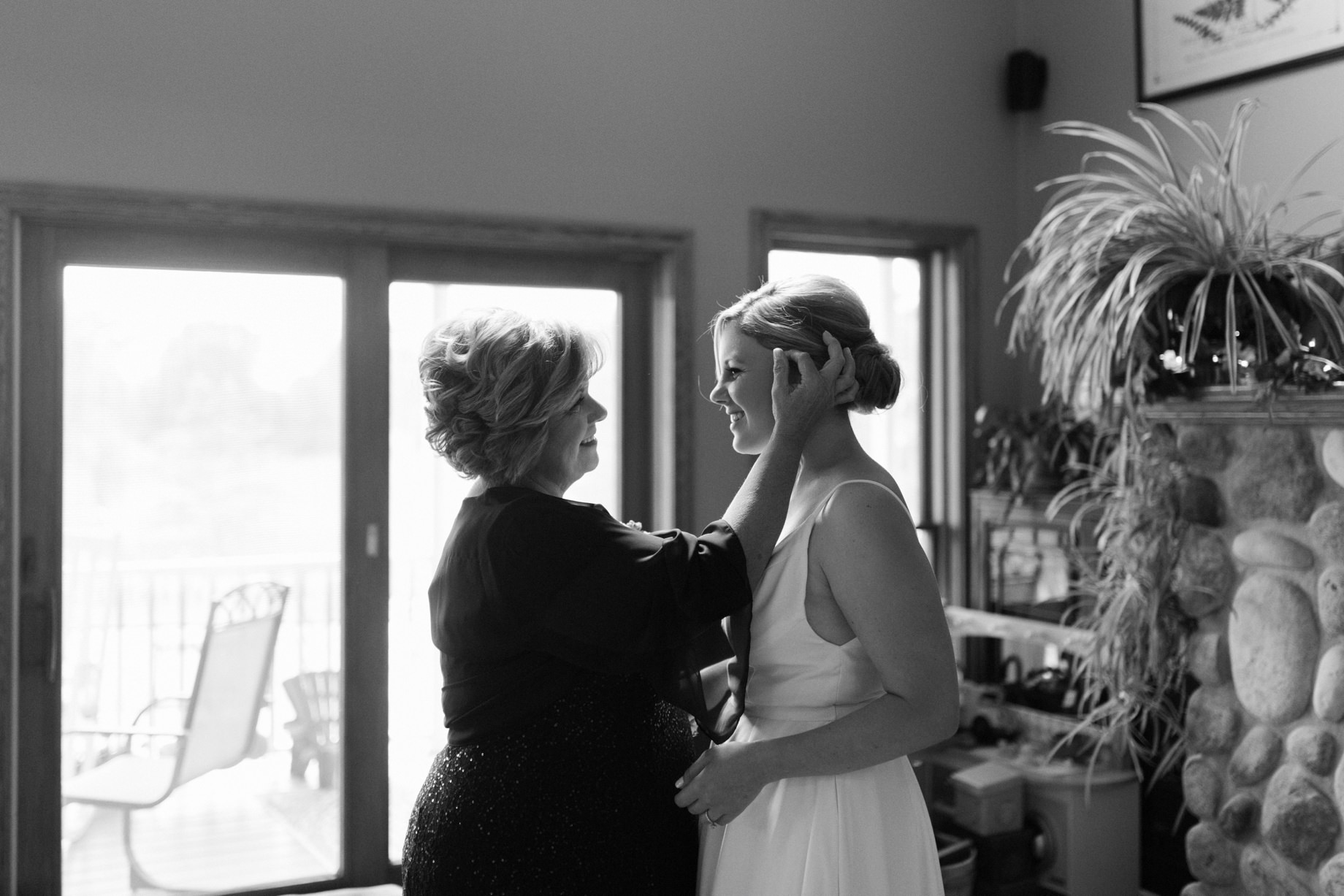 a mother takes a moment to admire her daughter on her wedding day