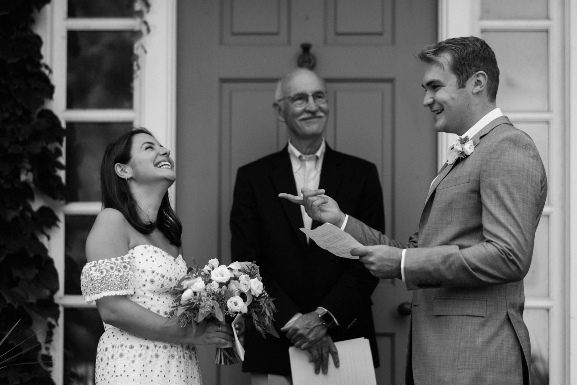 laughs shared during a wedding ceremony by photojournalistic Detroit wedding photographer Heather Jowett