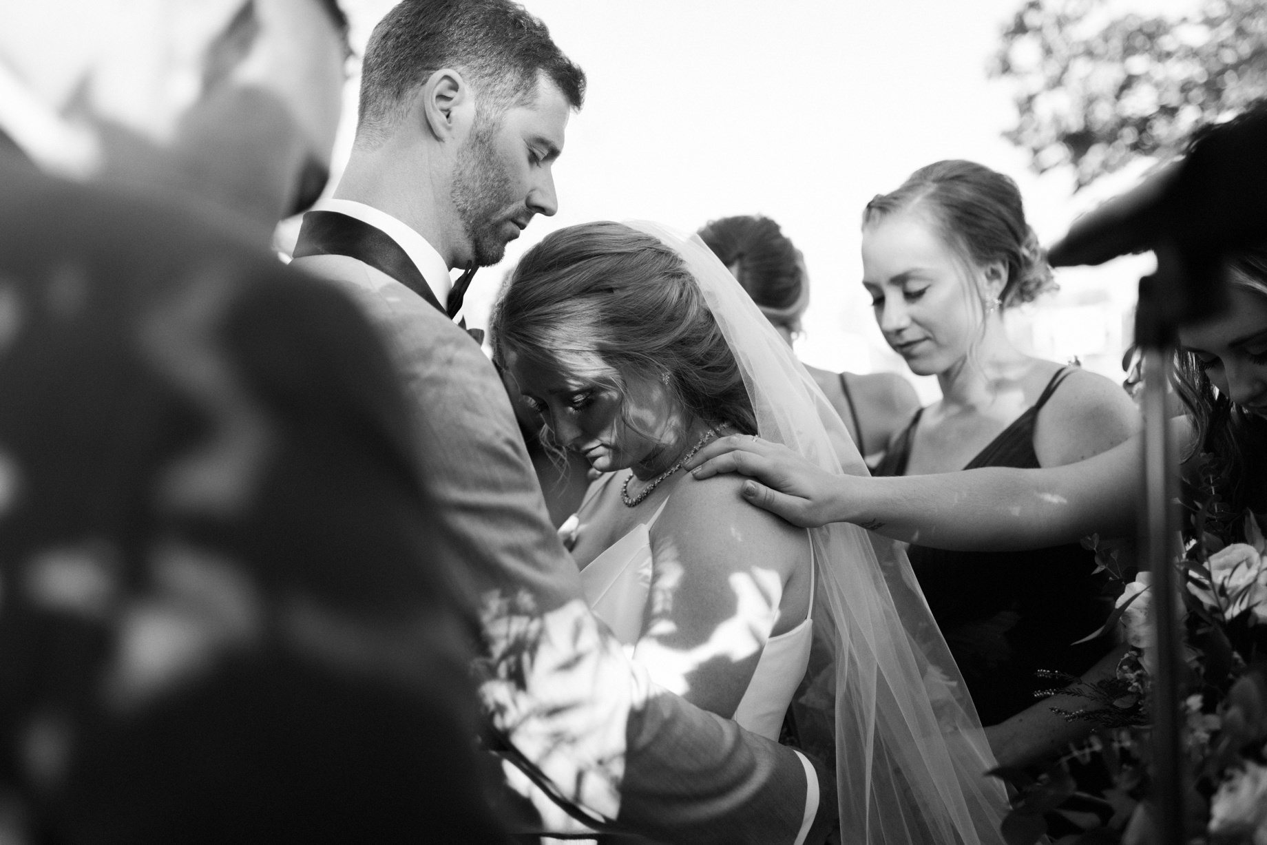 a couple is prayed for during their wedding ceremony