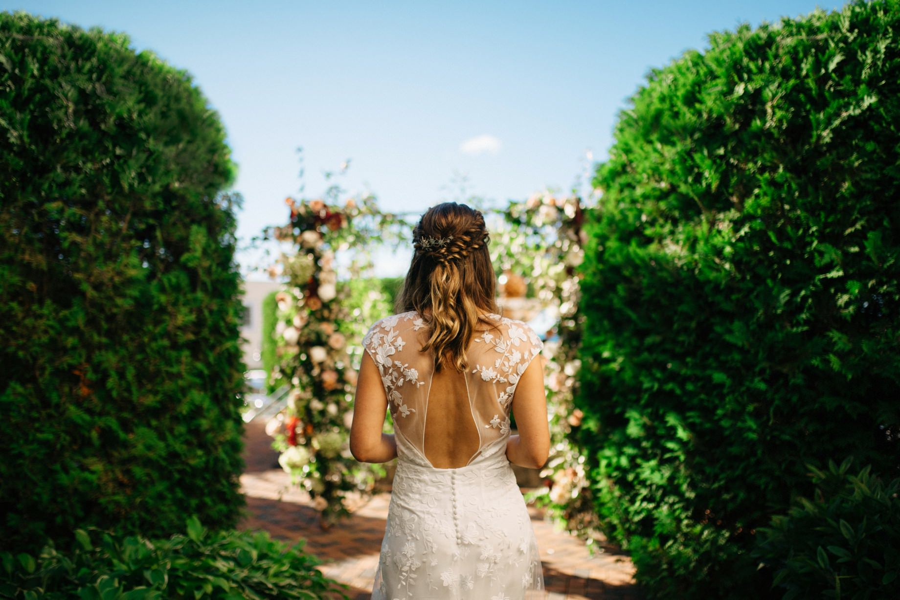 a bride in the rose garden at the perry hotel in petoskey