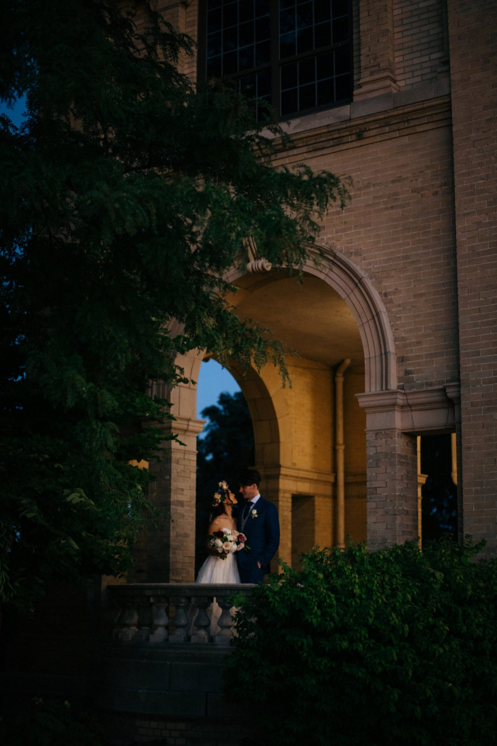 a portrait of a couple at the belle isle casion by photojournalistic Detroit wedding photographer Heather Jowett