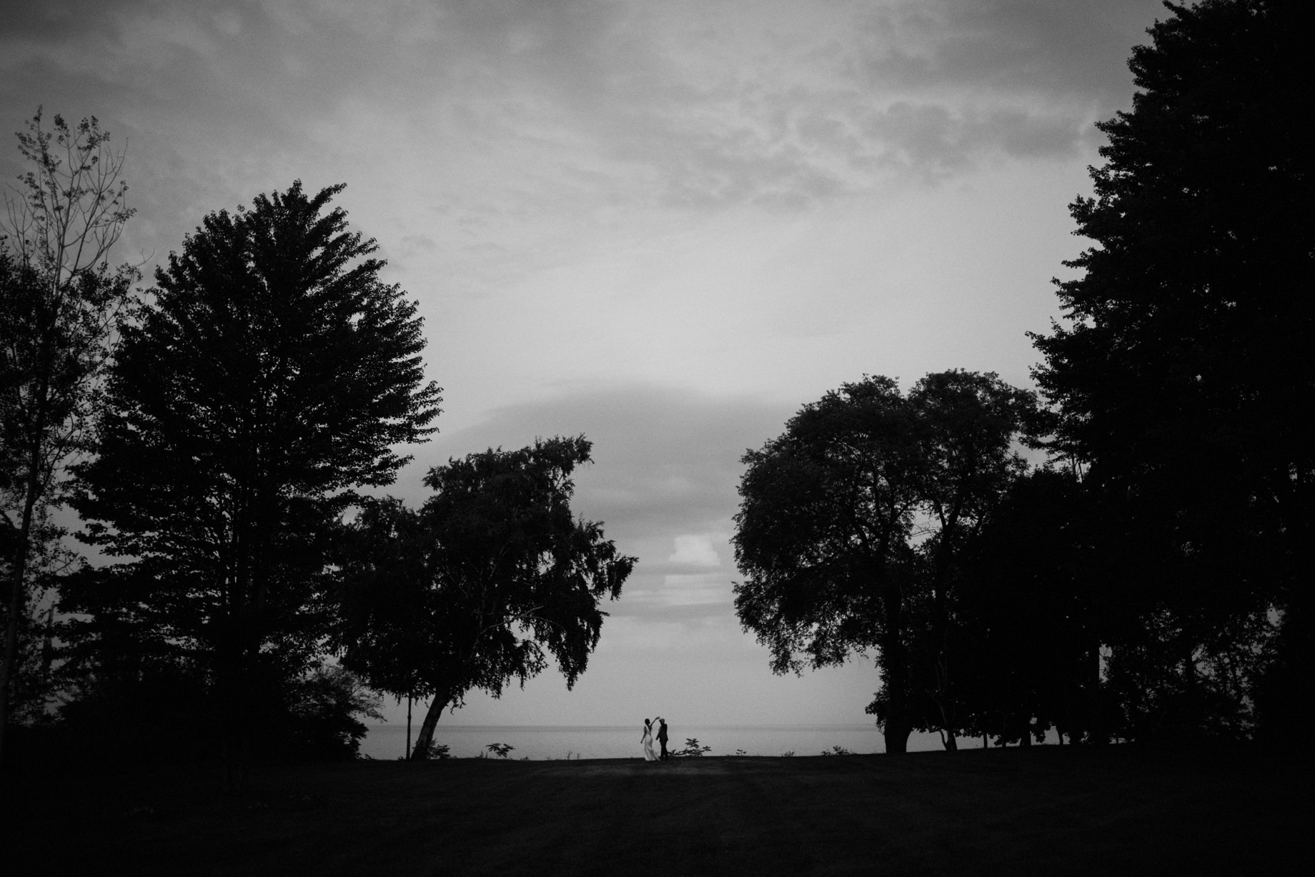 scenic portrait of a couple on the coast of lake huron